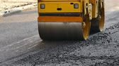 steamroller : Road roller doing road repair and paving of streets, Slow Motion Video clip Stock Footage