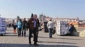 frequent : PRAGUE - March 13: Tourist traffic on Charles Bridge in Prague March 13, 2014 in Prague, Czech Republic.