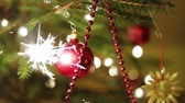 embellishment : Christmas tree with color balls and burning sparkler Stock Footage