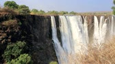 zambia : The Victoria Falls is the largest to the curtain of water in the world 1708 meters wide. The falls and the Surrounding area is the National Parks and World Heritage Site - Zambia, Zimbabwe