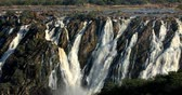 Намибия : Ruacana Falls on the Kunene River in Northern Namibia and Southern Angola Стоковые видеозаписи