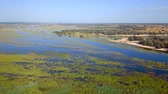 namibie : Aerial landscape in Okavango delta on Namibia and Angola border. River with shore and green vegetation after rainy season.
