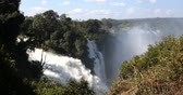 Victoria falls after the rain season in May, the waterfall is full of water, everywhere is mist. Zambia Zimbabwe border, Africa wilderness landscape. Wonder of the World Stock Footage