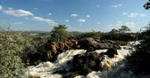 наводнение : beautiful Ruacana Falls on the Kunene River in Northern Namibia and Southern Angola, Africa wilderness landscape, Waterfall is full of water after the rain season. View from Angola side