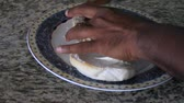 on hands : Preparing a bagel Stock Footage