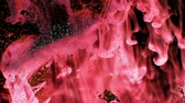 lentejoula : Pink and red ink of animated falling Creating and scrolls with dust particles floating around full hd