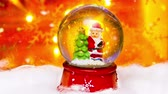 podsvícení : Snow dome Santa Claus, Christmas decoration on bright orange and yellow background and snow flakes falling animation Dostupné videozáznamy