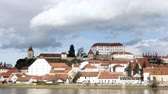 slovenya : Ptuj, Slovenia, time lapse pan of clouds moving over the oldest city in Slovenia with a castle overlooking the old town from a hill and the Drava river beneath
