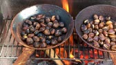 fruit vegetables : Chestnuts roasted on open fire, seasonal delicacy, harvest Stock Footage