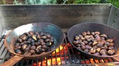 castanha : Chestnuts roasted on open fire, seasonal delicacy, harvest.