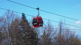 gezinmek : Maribor, Slovenia - May 2, 2019: Cable cars of Pohorska vzpenjaca cableway on the way to the top of Pohorje mountain. The cableway is essential for the Pohorje bike park.