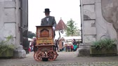 nostaljik : Slovenska Bistrica, Slovenia - Sept 7 2019: Vintage dressed man playing street organ at weekend fair in front of the castle gates in Slovenska Bistrica, Slovenia.