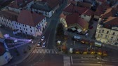 рынок : Slovenska Bistrica, Slovenia - Dec 25 2019: Christmas lights switch on in main square of small town Slovenska Bistrica, Slovenia, aerial time-lapse of Xmas market with decoration