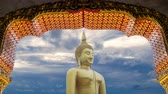 big great powerful Buddha statue in gold color with beautiful time lapse of sky with cloudy at sunset or sunrise time at background. Buddha image for Buddhists Stock Footage