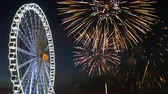 4K footage of giant ferris wheel with colorful firework festival in the sky for celebration at night background Stock Footage