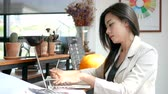 4K footage, busy business woman working with laptop computer and thinking with serious face in coffee shop cafe in the city in the morning , business people lifestyle. Asian model in her 30s Stock Footage