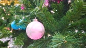colorful ornaments decorate on a Christmas tree.  greeting season video background
