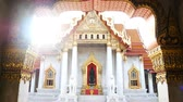 4K footage. The Marble Temple or Wat Benchamabophit Dusit Wanaram in morning time with sun beam on top of church, famous landmark place for tourist sight seeing in Bangkok Thailand