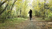sportwear : the girl in the forest Stock Footage