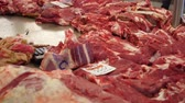 refrigerated : Showcase meat products in a supermarket. Russian market. Meat counters. Fresh meat on a table. The woman the seller sells meat in the market Stock Footage