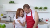 copy : Loving boyfriend feeding his smiling girlfriend in their kitchen while making breakfast. Stock Footage