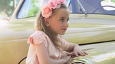 copy : The girl in a small pink dress at the retro car Stock Footage