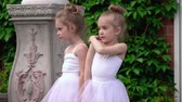sukénka : Two little ballerinas talk before ballet occupation on a porch of school
