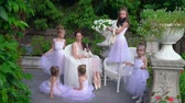 balet : Having rummaged in ballet school. The teacher with the little schoolgirls have a rest in the fresh air..
