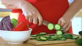 Woman chef. Female hands cut cucumber. Healthy food. Close up. 4K. Stok Video