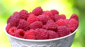 ассортимент : Raspberries super close up 4K stock footage. Raspberries in macro close up with a sliding camera move.Movement in a circle.