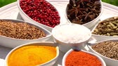 перчинка : Spices. Various Indian. Spice and herbs rotate. Assortment of Seasonings, condiments. Cooking ingredients, flavor. 4K video.