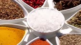 zafferano : Spices. Various Indian. Spice and herbs rotate. Assortment of Seasonings, condiments. Cooking ingredients, flavor. 4K video.