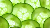 cucumber pieces : Top view of fresh sliced cucumber rotation.