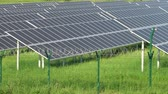 instalovat : Solar panels in a mountainous area near the road. Around the fence with barbed wire. Modern technologies.
