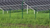 array : Solar panels in a mountainous area near the road. Around the fence with barbed wire. Modern technologies.