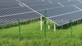 solarkraftwerk : Solar panels in a mountainous area near the road. Around the fence with barbed wire. Modern technologies.