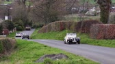 A 1948 Bentley and 1942 Praga Piccolo climb Southwaite Hill in Cumbria, England.  The cars are taking part in the 11th Flying Scotsman Rally, a free public-event.