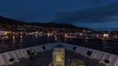 pov : A timelapse recording looking over the bow of a ship as it departs the city of Honningsvag, Norway. Stock Footage
