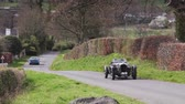 A 1936 Lagonda LG45 climbs Southwaite Hill in Cumbria, England.  The car is taking part in the 11th Flying Scotsman Rally, a free public-event.