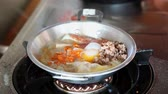 au : Chef Making Pan-Fried Egg with Chinese Sausage and Pork Topping