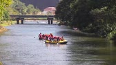 jangada : NAKHON NAYOK, THAILAND - JANUARY 1, 2018: Two Boats with Group of Young People Rafting on the River at Khun Dan Prakan Chon Dam, Popular Touristic Destination for Rafting in NAKHON NAYOK