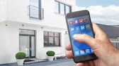 house : Smart House, home automation, device with app icons. Man uses his smartphone with smart home security app to lock the door of his house.