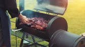 diet : Cooking  smoking delicious juicy meat steaks and sausages on the grill on fire and barbecue Smoker for smoke roasting