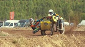 sportwear : wide shot of motocross racer on the dirt track - shot in slow motion Stock Footage