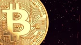 gonosz : Bitcoin - bit coin BTC cryptocurrency money burning in flames and fire sparkles Stock mozgókép
