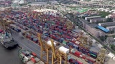Aerial footage of cargo ships and containers at seaport