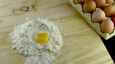 food and drink : egg dropping into flour in slow motion Stock Footage