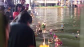 loi krathong : Muang, Pathumthani, Thailand Nov 22, 2018: Time lapse people bring decorated buoyant to the river on Loykratong festival at Full Moon Day of the Twelfth Lunar Month for apology to water goddess.