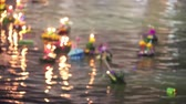 loi krathong : Muang, Pathumthani, Thailand Nov 22, 2018: Time lapse blur style decorated buoyant floating on the water on Loykratong festival at Full Moon Day of the Twelfth Lunar Month. Stock Footage
