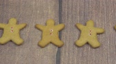 icings : Gingerbread men on a brown wooden table
